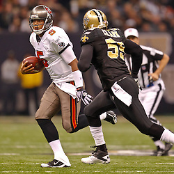 January 2, 2011; New Orleans, LA, USA; New Orleans Saints linebacker Danny Clark (55) pursues Tampa Bay Buccaneers quarterback Josh Freeman (5) during the first quarter at the Louisiana Superdome. Mandatory Credit: Derick E. Hingle