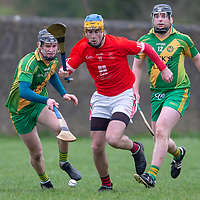 Eire Og's Dara Walsh is pursued by O'Callaghan's Mills's Sean Cotter and Kevin O'Callaghan