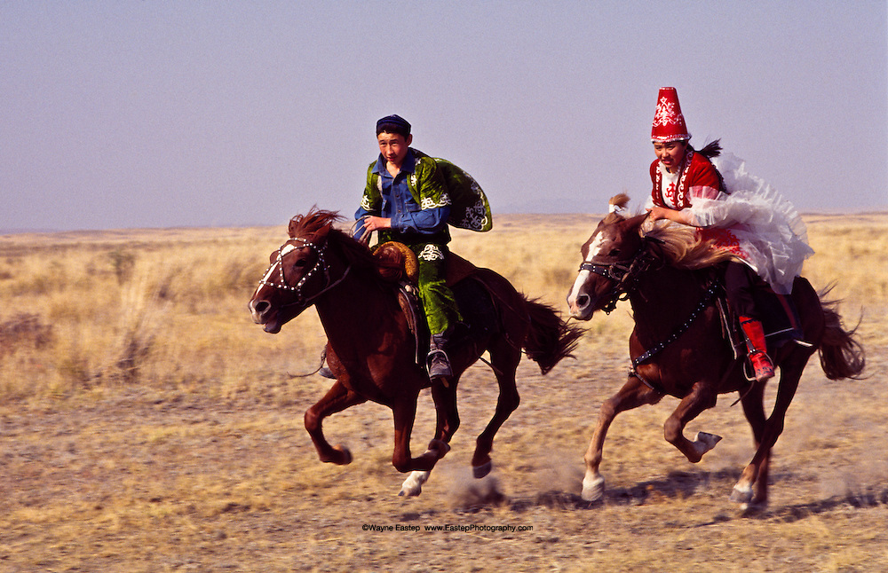 "Qiz Quu, or 'chasing the girl,' is another well-loved horseback game in Kazakhstan.  If the boy wins the race, he gets to kiss the girl on the ride back to the starting line.  if the girl wins, she gets to ""whip"" the boy on the ride back.  This game took place in the village of Zhibebai."