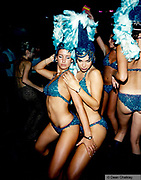 Dancers dressed in sparkly bikinis with feather hats Ibiza 1998