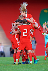 NEWPORT, WALES - Tuesday, June 12, 2018: Wales' Kayleigh Green (left) celebrates scoring the second goal with team-mates during the FIFA Women's World Cup 2019 Qualifying Round Group 1 match between Wales and Russia at Newport Stadium. (Pic by David Rawcliffe/Propaganda)