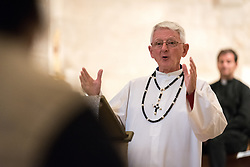 15 April 2019, Jerusalem: Rev. Fr Dave Sullivan of the Missionaries of Africa of St Anne's Monastery and Basilica shares a reflcetion, as Ecumenical Accompaniers (EAs) from the World Council of Churches gather in Saint Anne's Basilica in Jerusalem. Through a candlelight ceremony, one group of EAs pass on the challenge of their ministry to another. Each group of accompaniers spends three months in the Holy Land, providing protective presence, monitoring human rights violations, and collecting documentation of life under occupation, as well as initiatives for peace.
