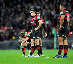 Saracens fly half Owen Farrell crouches dejected after missing a late drop goal opportunity to win the game - Photo mandatory by-line: Patrick Khachfe/JMP - Tel: 07966 386802 - 18/10/2013 - SPORT - RUGBY UNION - Wembley Stadium, London - Saracens v Toulouse - Heineken Cup Round 2.