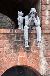 © Licensed to London News Pictures; 10/09/2020; Bristol, UK. On World Suicide Prevention Day a sculpture has appeared overnight in an alcove above Jacobs Wells Road. The sculpture shows a person in a hoodie covering their face with their hands, being comforted by a teddy bear standing next to them. The sculpture catches the attention of passers by including pupils at the nearby QEH school. It is thought that the sculptor is the latest piece by an artist whose works have appeared around Bristol in recent years, most recently including a character sporting a string vest and beer belly next to the site where Colston's statue was famously toppled from its plinth as well as a bespectacled OAP on Victoria Street. Photo credit: Simon Chapman/LNP.
