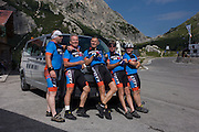A group of cycling mates gather for a photo on the Passo Falzarego (Pass) in the Dolomites, south Tyrol, Italy.