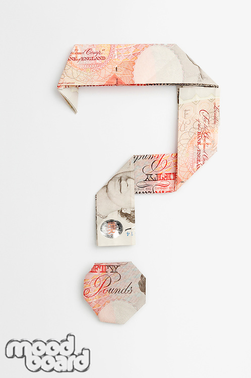 Question mark symbol made of folded banknotes