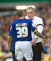 CARDIFF, ENGLAND - Saturday, August 21, 2010: Cardiff City's Craig Bellamy and manager Dave Jones during the Football League Championship match against Doncaster Rovers at the Cardiff City Stadium. (Pic by: David Rawcliffe/Propaganda)