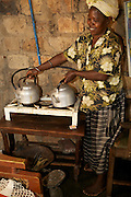 Nusula Ssewanonda is a member of Kirangira Womens group in Mukono District, Uganda. Here she is using the recently installed bio gas system to cook and provide light in the house. It all began with a cow that had a bull calf. She sold the calf to buy the drainpipe and tank. This generates money that she has then put together with money made from the sales of excess fruit and vegetable to buy the bio gas.