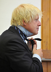 © licensed to London News Pictures. LONDON, UK.  09/09/11. Boris Johnson puts on a the school tie gifted to him by the headmaster and pupils. London Mayor Boris Johnson joins Chair of Governors Toby Young to officially open the The West London Free School (WLFS). The WLFS is an 11-18 secondary school, which has been set up by a group of parents and teachers in Hammersmith. The school is led by headmaster Thomas Packer . Mandatory Credit Stephen Simpson/LNP