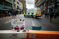 © Licensed to London News Pictures. 01/09/2019. Manchester, UK. Car-mageddon placard placed by traffic barriers on Deansgate . Extinction Rebellion block roads around Deansgate in Manchester City Centre , during a third day of planned disruption organised by environmental campaigners . Manchester City Council has declared a climate emergency but activists say the council's development plans do not reflect this . Photo credit: Joel Goodman/LNP
