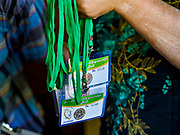 19 NOVEMBER 2017 - HWAMBI, YANGON REGION, MYANMAR: A worker at Sacred Heart's Catholic Church in Hwambi carries a stack of credentials for people going to the Papal Mass in Yangon on November 29. Catholics in Myanmar are preparing for the visit of Pope Francis. He is coming to the Buddhist majority country November 27-30. There about 500,000 Catholics in Myanmar, about 1% of the population. Catholicism was originally brought to what is now Myanmar more than 500 years ago by Portuguese missionaries and traders.    PHOTO BY JACK KURTZ