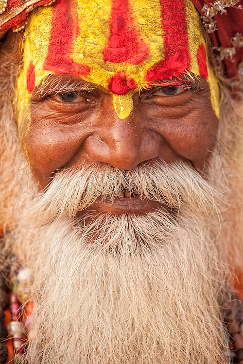 A portrait of a sadhu (holy man) at the Mani Karnika (Main) Ghat on the banks of the Ganges River in Varanasi India.
