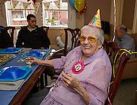 "Helen Clark ""Big Gram"" shows she still just a kid at heart donning a ""party hat"" in celebration of her 100th birthday surrounded by her family at the Genesis Rehab Facility on Sunday afternoon.  (Karen Bobotas/for the Laconia Daily Sun)"