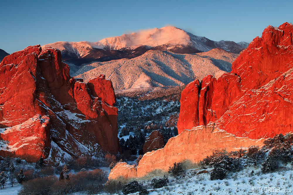 The colorful rocks of Garden of the Gods park frame Pikes Peak 14,110ft, Colorado Springs, Colorado.