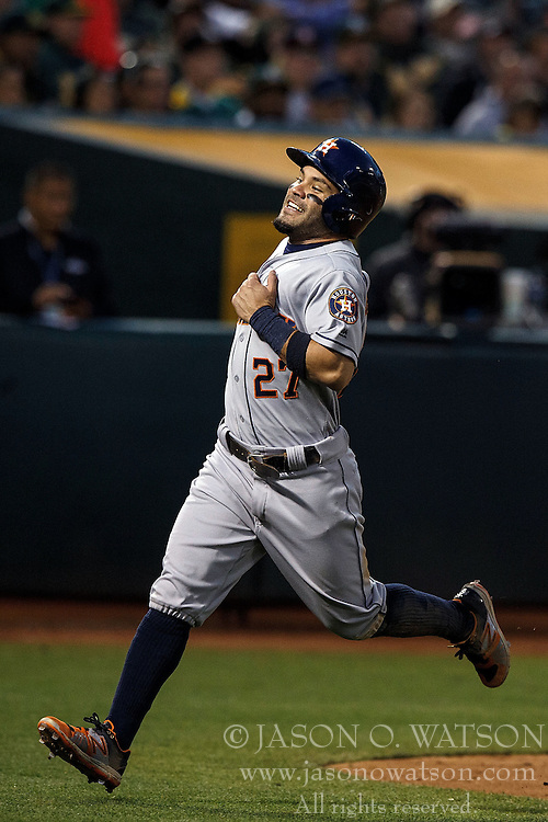 OAKLAND, CA - JULY 19:  Jose Altuve #27 of the Houston Astros scores a run against the Oakland Athletics during the fifth inning at the Oakland Coliseum on July 19, 2016 in Oakland, California. The Oakland Athletics defeated the Houston Astros 4-3 in 10 innings.  (Photo by Jason O. Watson/Getty Images) *** Local Caption *** Jose Altuve