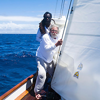 A rasta man and an older Jerry Garcia look-alike work on the bow during the 2008 Antigua Classic Yacht Regatta . This race is one of the worlds most prestigious traditional yacht races. It takes place annually off the cost of Antigua in the British West Indies. Antigua is a yachting haven, historically a british navy base in the times of Nelson.