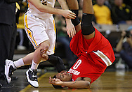 January 04 2010: Ohio State Buckeyes forward Jared Sullinger (0) finds himself upside down during the second half of an NCAA college basketball game at Carver-Hawkeye Arena in Iowa City, Iowa on January 04, 2010. Ohio State defeated Iowa 73-68.