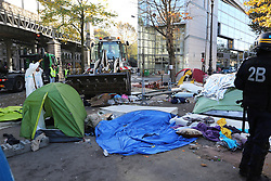 "Workers carried wastes during dismantling the Jaures/Stalingrad refugees camp dismantelment in Paris, France, on 31 October 2016. An operation of ""administrative control"" was underway on early October 31 in the Jaures/Stalingrad quarter before a future evacuation, whose date has not yet been set, according to a police source. The makeshift camp on the outskirts of the 10th and 19th arrondissements in the north of the capital numbers today 2,500 people, according to the City of Paris. Photo by Somer/ABACAPRESS.COM"