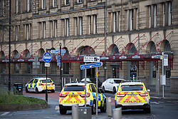 © Licensed to London News Pictures . 01/01/2019 . Manchester, UK. Police outside Victoria Station this morning (Tuesday 1st January 2018) after anti terrorism police closed off Victoria Station in Manchester and launched an investigation after several people were stabbed , including a British Transport Police officer , in a knife attack last night (Monday 31st December 2018). A man is under arrest for attempted murder . Photo credit: Joel Goodman/LNP