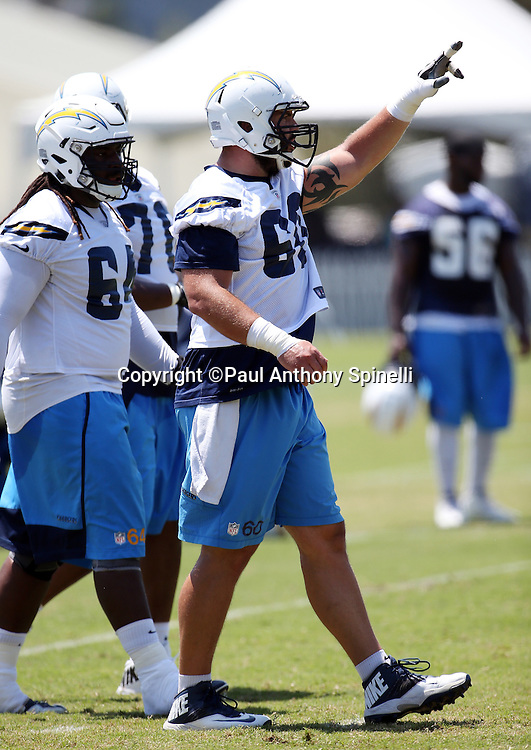 San Diego Chargers center Trevor Robinson (60) points during the San Diego Chargers Spring 2015 NFL minicamp practice on Wednesday, June 17, 2015 in San Diego. (©Paul Anthony Spinelli)
