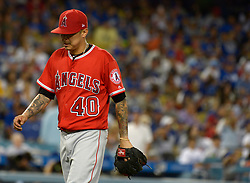 June 27, 2017 - Los Angeles, California, U.S. - Los Angeles Angels starting pitcher Jesse Chavez walks toward the dugout after being pulled from the game in the sixth inning of a Major League baseball game against the Los Angeles Dodgers at Dodger Stadium on Tuesday, June 27, 2017 in Los Angeles. (Photo by Keith Birmingham, Pasadena Star-News/SCNG) (Credit Image: © San Gabriel Valley Tribune via ZUMA Wire)