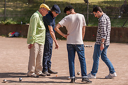 "© Licensed to London News Pictures. 05/06/2015.   London, UK. Jim Beach (left), manager of the rock band, Queen, and Monty Python star, Eric Idle (second left), take part in ""Freddie for the Day"", by playing a special game of celebrity Pétanque, competing for the Londonaise 'Celebrity Pétanque Trophy', ahead of The Londonaise Pétanque festival this weekend in Barnard Park, Islington.  The festival will set a new precedent in the UK with 128 teams taking part in the main tournament.  The event also aims to raise funds for the Mercury Phoenix Trust to fight against AIDS worldwide. Photo credit : Stephen Chung/LNP"
