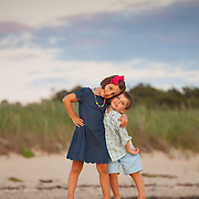 A portrait of two children on a beach on Cape Cod