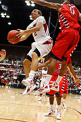 Nov 14, 2011; Stanford CA, USA;  Stanford Cardinal guard Aaron Bright (2) shoots past Fresno State Bulldogs forward Jerry Brown (0) during the first half of a preseason NIT game at Maples Pavilion. Mandatory Credit: Jason O. Watson-US PRESSWIRE