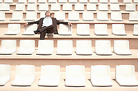 Businessman Relaxing in Auditorium front view.