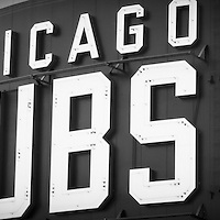 Chicago Cubs sign panoramic picture in black and white. Panorama photo ratio is 1:3. The Chicago Cubs sign is on Wrigley Field which is a Chicago landmark baseball field that was built in 1914 and is home to the Chicago Cubs Major League Baseball team.