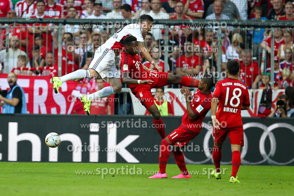 29.08.2015, Allianz Arena, Muenchen, GER, 1. FBL, FC Bayern Muenchen vs Bayer 04 Leverkusen, 3. Runde, im Bild l-r: im Zweikampf, Aktion, Kopfballduell mit Roberto Hilbert #13 (Bayer 04 Leverkusen) und David Alaba #27 (FC Bayern Muenchen), Douglas Costa #11 (FC Bayern Muenchen), Juan Bernat #18 (FC Bayern Muenchen) // during the German Bundesliga 3rd round match between FC Bayern Munich and Bayer 04 Leverkusen at the Allianz Arena in Muenchen, Germany on 2015/08/29. EXPA Pictures &copy; 2015, PhotoCredit: EXPA/ Eibner-Pressefoto/ Kolbert<br /> <br /> *****ATTENTION - OUT of GER*****