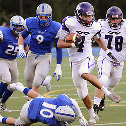Photos by Tom Kelly IV<br /> Phoenixville's Mackensie Thomas (4) runs passed Great Valley's Doug Stang (10) during the Great Valley vs Phoenixville high school football game, Saturday night August 31, 2013 at Great Valley High School in East Whiteland.