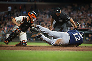 San Francisco Giants catcher Nick Hundley (5) tags Milwaukee Brewers catcher Stephen Vogt (12) out at home plate at AT&T Park in San Francisco, California, on August 21, 2017. (Stan Olszewski/Special to S.F. Examiner)
