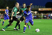 AFC Wimbledon striker Lyle Taylor (33) and Scunthorpe United midfielder Neil Bishop (12) and Scunthorpe United defender Conor Townsend (22) during the EFL Sky Bet League 1 match between AFC Wimbledon and Scunthorpe United at the Cherry Red Records Stadium, Kingston, England on 16 August 2016. Photo by Stuart Butcher.