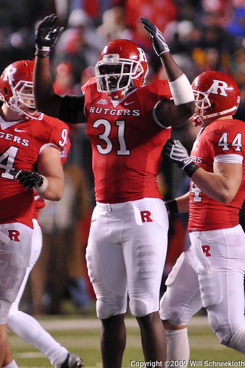 Oct 16, 2009; Piscataway, NJ, USA; Rutgers defensive end George Johnson (31) encourages fans during second half NCAA football action in Pittsburgh's 24-17 victory over Rutgers at Rutgers Stadium.