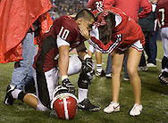 Garden Grove's Christian Trejo is conforted by a cheerleader after their 49-27 loss to La Mirada in the Southern Division football championship game at Orange Coast College Friday night...///ADDITIONAL INFO:  southern.1212.kjs.jpg  ---  Photo by Kevin Sullivan, The Orange County Register --  12/11/09..Garden Grove vs. La Mirada in Southern Division football championship game at Orange Coast College. Need game action for print and Web slide show. Also need photos of Garden Grove fans for slide show. Please shoot any fans' tributes to Kevin Telles, who died early in the season... 12/11/09