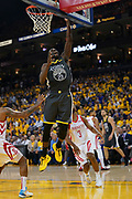 April 30, 2019; Oakland, CA, USA; Golden State Warriors forward Draymond Green (23) shoots the basketball against Houston Rockets guard Chris Paul (3) during the third quarter in game two of the second round of the 2019 NBA Playoffs at Oracle Arena. The Warriors defeated the Rockets 115-109.