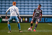 Morecambe  midfielder Aaron Wildig (15)  plays the ball forward during the The FA Cup match between Coventry City and Morecambe at the Ricoh Arena, Coventry, England on 15 November 2016. Photo by Simon Davies.