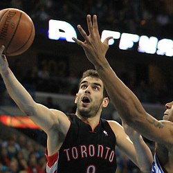 06 February 2009: Toronto Raptors guard Jose Calderon (8) shoots over New Orleans Hornets forward David West (30) during a NBA game between the New Orleans Hornets and the Toronto Raptors at the New Orleans Arena in New Orleans, LA.