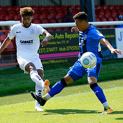 Dover's Josh Passley crosses the ball past Gillingham's Aaron Simpson during the pre-season friendly match between Dover Athletic and Gillingham FC at Crabble Stadium, Kent on 21 July 2018. Gillingham ran out 3 to nothing winners. Photo by Matt Bristow.