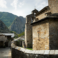View of small village of Peñalba de Santiago with its stone church and mountains on the background