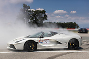 Burnout in the circuit of Balocco. The Ferrari Cavalcade is an event reserved for the best customers of the Maranello factory. In this 7th edition, the Mont Blanc was chosen. 110 Ferrari, coming from 30 different countries, have covered more than 1000 km between Italy, France and Switzerland.