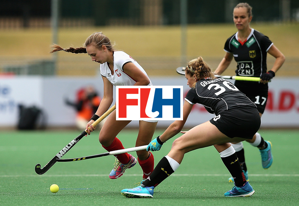 JOHANNESBURG, SOUTH AFRICA - JULY 08:  Sandra Tatarczuk of Poland and Hanna Granitzki of Germany battle for possession during the pool A match between Germany and Poland on day one of the FIH Hockey World League Semi-Final at Wits University on July 8, 2017 in Johannesburg, South Africa.  (Photo by Jan Kruger/Getty Images for FIH)