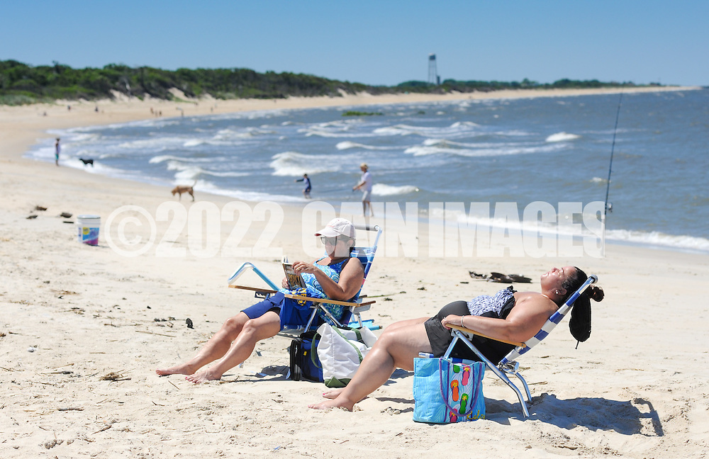 Sunbathers sits on beach chairs Saturday July 2, 2016 at Higbee Beach in Cape May, New Jersey. Photo by William Thomas Cain/Cain Images