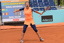 May 11, 2017 - Madrid, Spain - SIMONA HALEP of Romania celebrates winning her quarterfinal doubles match with I. Begu in the Mutua Madrid Open tennis tournament. (Credit Image: © Christopher Levy via ZUMA Wire)