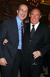 Left to right, PAUL McKENNA and ANDREW NEIL at The Business Winter Party hosted by Andrew Neil at The Ritz Hotel, Piccadilly, London on 7th December 2005.<br />