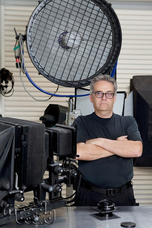 Portrait of a technician with arms crossed standing in photographer's studio