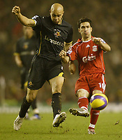 Photo: Aidan Ellis.<br /> Liverpool v Watford. The Barclays Premiership. 23/12/2006.<br /> Liverpool's Luis Garcia gets his pass away despite being under pressure from Watford's Gavin Mahon
