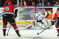 KELOWNA, BC - OCTOBER 12: Dylan Garand #31 of the Kamloops Blazers defends the net as Nolan Foote #29 of the Kelowna Rockets skates in for the shot at Prospera Place on October 12, 2019 in Kelowna, Canada. (Photo by Marissa Baecker/Shoot the Breeze)