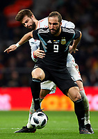 MADRID, SPAIN - MARCH 27:  Gerard Pique of Spain competes for the ball with Gonzalo Higuain of Argentina during the international friendly match between Spain and Argentina at Wanda Metropolitano stadium on March 27, 2018 in Madrid, Spain.  (Photo by Quality Sport Images/Getty Images)
